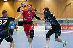 07.10.2020, Klingenhalle, Solingen,  GER, 1. HBL. Herren, Bergischer HC vs. HC Erlangen, <br /> <br /> im Bild / picture shows: <br /> Simon Jeppsson (HC Erlangen #42), im Zweikampf gegen  Csaba Szücs / Szuecs (BHC #20), Jeffrey Boomhouwer (BHC #32),  <br /> <br /> <br /> Foto © nordphoto / Meuter *** Local Caption ***