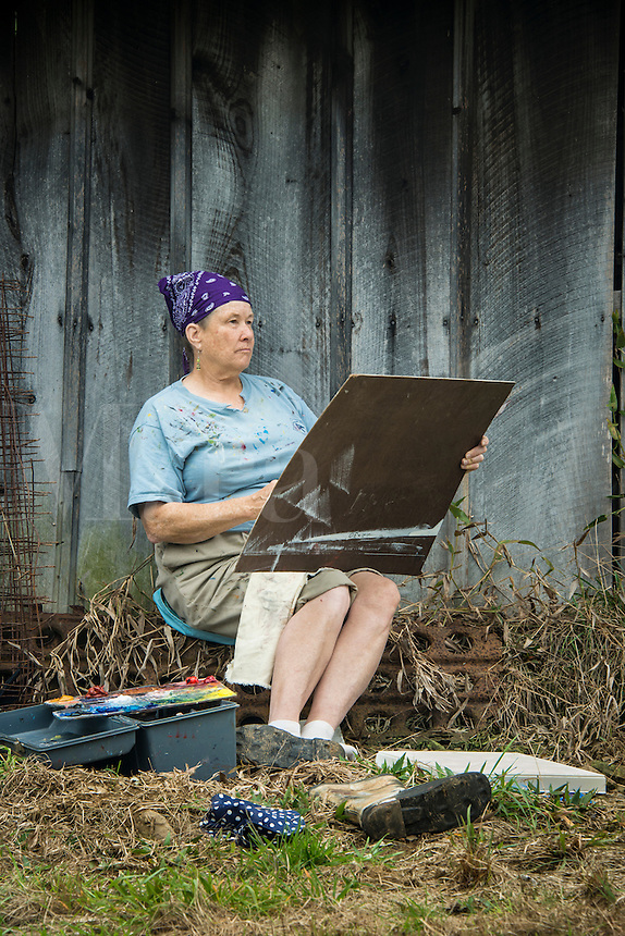 Plein air artist studies her subject.