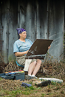 Plein air artist studies her subject.
