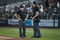 Umpires Kelvis Velez (left) and Emil Jimenez (right) chat between innings of the game between the Altoona Curve and the Somerset Patriots at TD Bank Ballpark on July 24, 2021, in Somerset NJ. (Brian Westerholt/Four Seam Images)