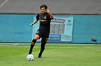 LOS ANGELES, CA - OCTOBER 25: Carlos Vela #10 of LAFC moves with the ball during a game between Los Angeles Galaxy and Los Angeles FC at Banc of California Stadium on October 25, 2020 in Los Angeles, California.