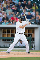 Tyler Colvin (26) of the Charlotte Knights at bat against the Rochester Red Wings at BB&T BallPark on August 8, 2015 in Charlotte, North Carolina.  The Red Wings defeated the Knights 3-0.  (Brian Westerholt/Four Seam Images)