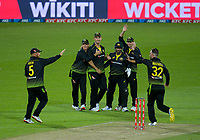 The Australian team celebrates the dismissal of NZ captain Kane Williamson during the 4th international men's T20 cricket match between the New Zealand Black Caps and Australia at Sky Stadium in Wellington, New Zealand on Friday, 5 March 2021. Photo: Dave Lintott / lintottphoto.co.nz