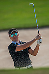 Tenniel Chu, Vice Chairman of Mission Hills Group, plays a shot during the Hyundai China Ladies Open 2014 on December 09 2014 at Mission Hills Shenzhen, in Shenzhen, China. Photo by Xaume Olleros / Power Sport Images