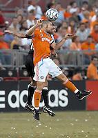 Houston Dynamo defender Wade Barrett (24) and D.C. United midfielder Ben Olsen (14) go for the header.  Houston Dynamo defeated D.C. United 1-0 at Robertson Stadium in Houston, TX on July 8, 2007.