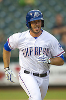 Round Rock Express first baseman J.P. Arencibia (10) runs to first base during the Pacific Coast League baseball game against the New Orleans Zephyrs on May 27, 2014 at the Dell Diamond in Round Rock, Texas. The Zephyrs defeated the Express 9-0 in a rain shortened game. (Andrew Woolley/Four Seam Images)