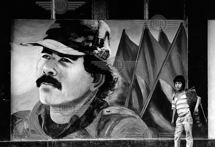 A shoeshine boy next to a mural of President Daniel Ortega during the 1990 election campaign, which Ortega's Sandinista National Liberation Front (FSLN) lost.