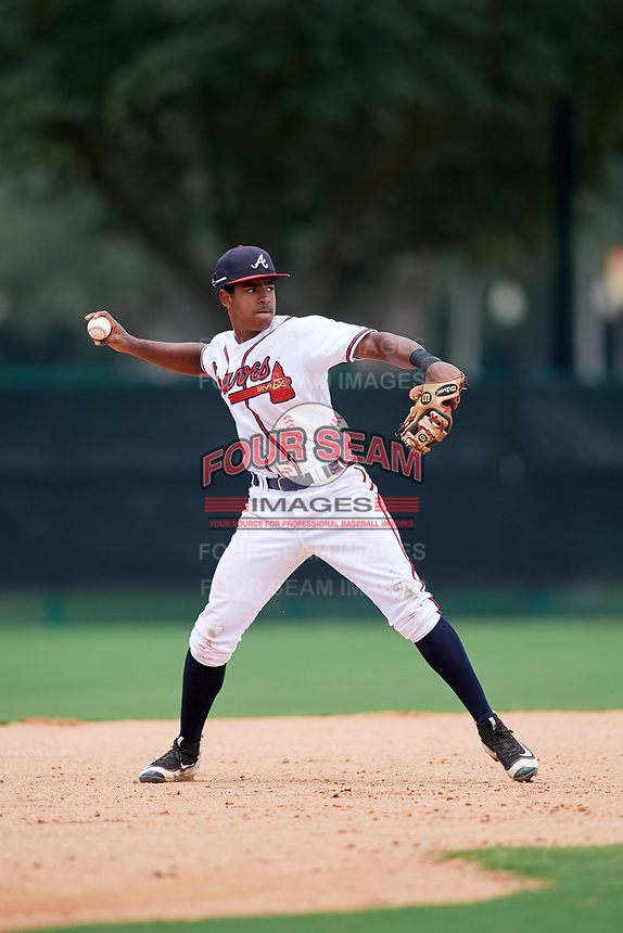 GCL Braves third baseman Braulio Vasquez (20) throws to first base during the second game of a doubleheader against the GCL Yankees West on July 30, 2018 at Champion Stadium in Kissimmee, Florida.  GCL Braves defeated GCL Yankees West 5-4.  (Mike Janes/Four Seam Images)