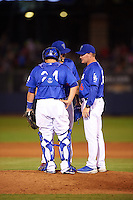 Tulsa Drillers pitching coach Matt Herges (36) talks with pitcher Ralston Cash and catcher Ali Solis (24) during a game against the Midland RockHounds on June 2, 2015 at Oneok Field in Tulsa, Oklahoma. Midland defeated Tulsa 6-5. (Mike Janes/Four Seam Images)