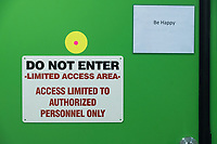"Signs reading ""Do not enter / Limited Access Area"" and ""Be Happy"" are seen on a cultivation room door at the production and packaging facility for Garden Remedies, a medical cannabis producer, in Fitchburg, Massachusetts, USA, on Fri., Feb. 22, 2019."