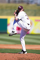 Pierce Johnson (34) of the Missouri State Bears winds up during a game against the Southern Illinois University- Edwardsville Cougars at Hammons Field on March 10, 2012 in Springfield, Missouri. (David Welker / Four Seam Images).