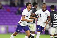 ORLANDO CITY, FL - JANUARY 31: Miles Robinson #12 of the United States celebrates his goal during a game between Trinidad and Tobago and USMNT at Exploria stadium on January 31, 2021 in Orlando City, Florida.