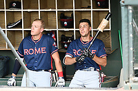 Greyson Jenista (23), left, and AJ Graffanino (16) of the Rome Braves wait at the bat rack for a game to begin against the Greenville Drive on Wednesday, July 11, 2018, at Fluor Field at the West End in Greenville, South Carolina. The two are among the Atlanta Braves' top 2018 draft picks. (Tom Priddy/Four Seam Images)