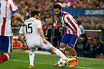 Atletico de Madrid's Arda Turan (R) and Real Madrid´s Daniel Carvajal during quarterfinal first leg Champions League soccer match at Vicente Calderon stadium in Madrid, Spain. April 14, 2015. (ALTERPHOTOS/Victor Blanco)