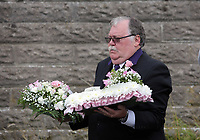 """COPY BY TOM BEDFORD<br />Pictured: A man carries floral tributes from the family home in Merthyr Tydfil, Wales, UK. Friday 18 August 2017<br />Re: The funeral of a toddler who died after a parked Range Rover's brakes failed and it hit a garden wall which fell on top of her will be held today at Jerusalem Baptist Chapel in Merthyr Tydfil.<br />One year old Pearl Melody Black and her eight-month-old brother were taken to hospital after the incident in south Wales.<br />Pearl's family, father Paul who is The Voice contestant and mum Gemma have said she was """"as bright as the stars""""."""