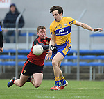 Caolan Mooney of  Down in action against Shane Brennan5 of Clare during their Division 2, Round 2 National League game at Cusack Park. Photograph by John Kelly.