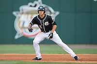 Trayce Thompson (15) of the Charlotte Knights takes his lead off of first base against the Lehigh Valley IronPigs at BB&T BallPark on May 30, 2015 in Charlotte, North Carolina.  The IronPigs defeated the Knights 1-0.  (Brian Westerholt/Four Seam Images)