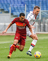Roma's Pedro, left, is challenged by Genoa's Domenico Criscito during the Italian Serie A Football match between Roma and Genoa at Rome's Olympic stadium, March 7, 2021.<br /> UPDATE IMAGES PRESS/Riccardo De Luca