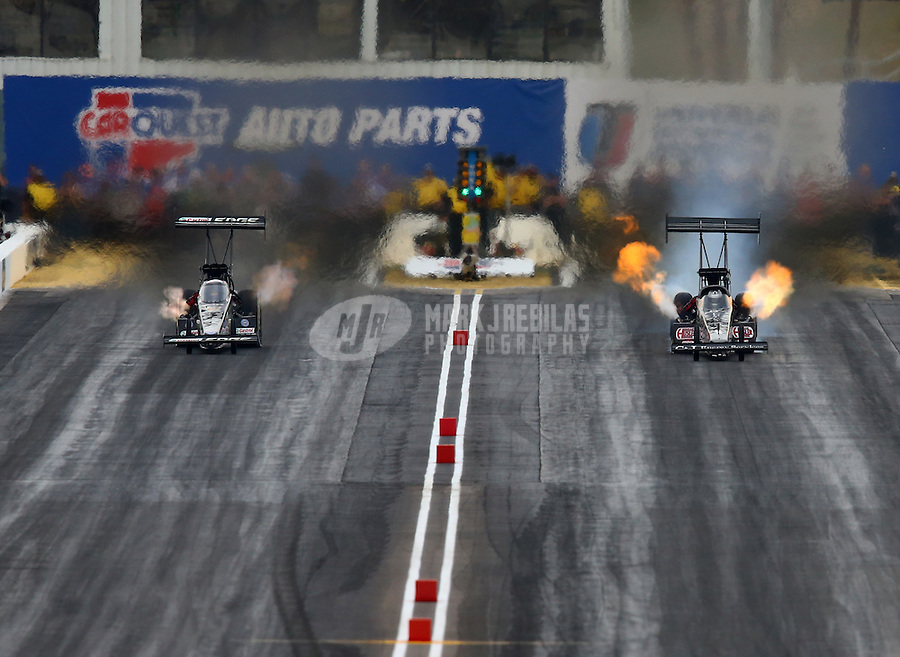 Feb 22, 2014; Chandler, AZ, USA; NHRA top fuel dragster driver Bob Vandergriff Jr (right) races alongside Brittany Force during qualifying for the Carquest Auto Parts Nationals at Wild Horse Motorsports Park. Mandatory Credit: Mark J. Rebilas-USA TODAY Sports