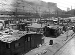Pittsburgh PA: Looking south toward the Pennsylvania Railroad's Union Station.   During the depression, the area from the PA RR Station to the 17th street bridge was called Shantytown.  Father Cox, a local priest, helped the residents through food kitchens and highlighting their plight.  Brady Stewart photographed the area for the City of Pittsburgh.