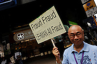 Hong Kong investors who lost money in the financial crisis through bad investements linked to Lehman Brothers demonstrate outside Dah Sing Bank in Central District of Hong Kong..