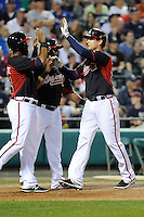 Designated hitter Kelly Johnson (24) of the Atlanta Braves is congratulated after his three-run home run in a Spring Training game against the New York Yankees on Wednesday, March 18, 2015, at Champion Stadium at the ESPN Wide World of Sports Complex in Lake Buena Vista, Florida. The Yankees won, 12-5. (Tom Priddy/Four Seam Images)