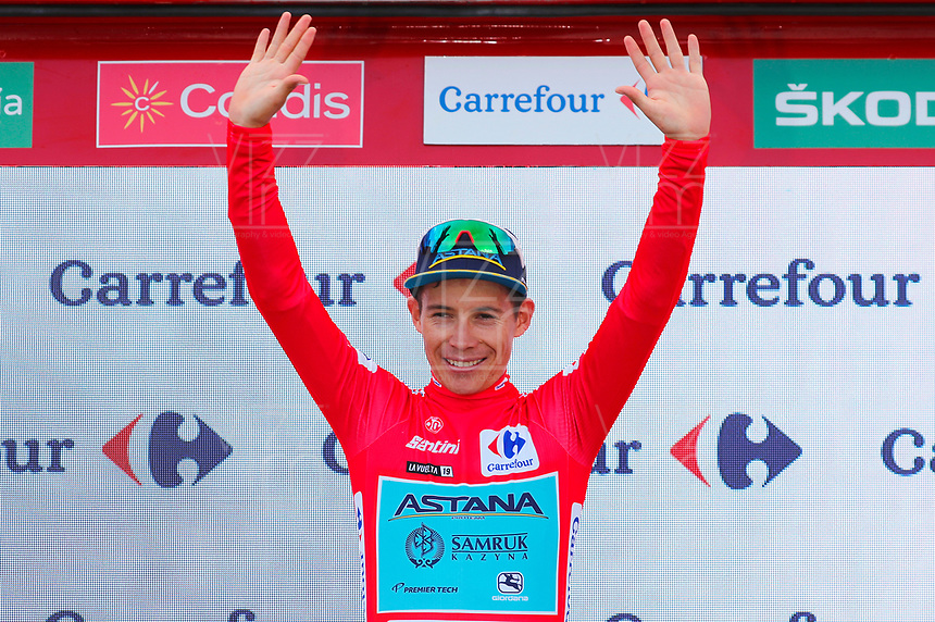 ESPAÑA, 28-08-2019: Miguel Angel lopez (COL - ASTANA) celebra con el maillot rojo lider general después de la etapa 5, hoy, 28 de agosto de 2019, que se corrió entre L' Eliana y el Observatorio Astrofísico de Javalambre con una distancia de 170,7 km como parte de La Vuelta a España 2019 que se disputa entre el 24/08 y el 15/09/2019 en territorio Español. / Miguel Angel lopez (COL - ASTANA) celebrates with red leader jersey after stage 5 today, August 28, 2019, from L'Eliana to Javalambre Astrophysical Observatory with a distance of 170,7 km as part of Tour of Spain 2019 which takes place between 08/24 and 09/15/2019 in Spain.  Photo: VizzorImage / Luis Angel Gomez / ASO<br /> VizzorImage PROVIDES THE ACCESS TO THIS PHOTOGRAPH ONLY AS A PRESS AND EDITORIAL SERVICE AND NOT IS THE OWNER OF COPYRIGHT; ANOTHER USE HAVE ADDITIONAL PERMITS AND IS  REPONSABILITY OF THE END USER