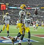 Green Bay Packers receiver James Jones tosses the ball to the referee afterscoring a touchdown against the Atlanta Falcons during the second quarter of the Divisional round playoff game at the Georgia Dome in Atlanta, Ga., on Saturday, Jan. 15, 2011. Greg Jennings (85) and Brandon Jackson (32) celebrate also.