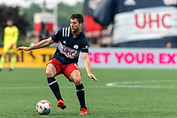 FOXBOROUGH, MA - AUGUST 8: Matt Polster #8 of New England Revolution dribbles during a game between Philadelphia Union and New England Revolution at Gillette Stadium on August 8, 2021 in Foxborough, Massachusetts.
