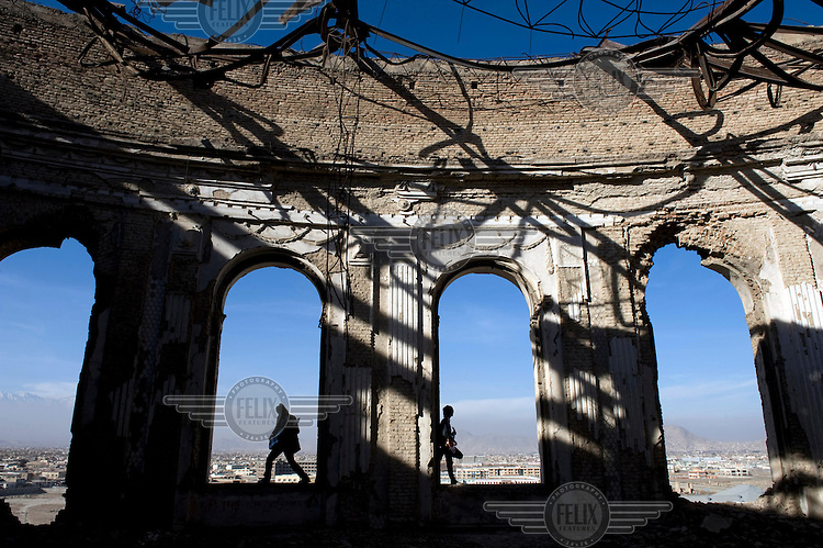 Guitarists of rock band Kabul Dreams play their instruments in the ruins of a castle in Kabul. Kabul Dreams is made up of singer/guitarist Sulyman Qardash, bass player Siddique Ahmad and drummer Mujtaba Habibi, and they claim to be the country's first and only rock and roll group.