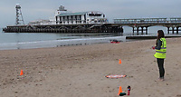 BNPS.co.uk (01202 558833)<br /> Pic: EllipsisEarth/BNPS<br /> <br /> Pictured: Ellipsis Earth CEO Ellie Mackay piloting a drone.<br /> <br /> Litter dropped in Britain's most popular seaside resort reduced by 75 per cent this summer thanks to a new project using drone technology.<br /> <br /> The first-of-its kind survey identified alarming litter patterns along Bournemouth beach in Dorset with a staggering 123,000 bits of litter discarded in just one week.<br /> <br /> The data was then used to target the worst areas with strategic bin placement.