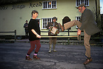 Farmer dancing a Broom Stick dance outside of the King Head Laxfield Suffolk UK.<br /> Carol Surname  and Tony Harvey, who farmed 2,000 acres at Tannington Old Hall, Suffolk. He also owned the Kings Head. He died 2007. 1980s