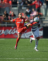 11 April 2009: Toronto FC midfielder Dwayne DeRosario # 14 and FC Dallas defender Blake Wagner #19 battle for a ball during MLS action at BMO Field Toronto, in a game between FC Dallas and Toronto FC. .Final score was a 1-1 draw.