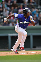 First baseman Josh Ockimey (18) of the Greenville Drive runs toward first base in a game against the Asheville Tourists on Sunday, April 10, 2016, at Fluor Field at the West End in Greenville, South Carolina. Greenville won 7-4. (Tom Priddy/Four Seam Images)