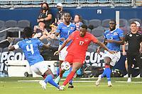 KANSAS CITY, KS - JULY 15: Cyle Larin #17 of Canada ,Ricardo Ade #4 of Haiti during a game between Canada and Haiti at Children's Mercy Park on July 15, 2021 in Kansas City, Kansas.