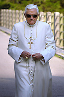 Pope Benedict XVI walk on the banks of a river of mountain while recitation of the Rosary, of private vacations in the Dolomite. Pope Benedict XVI looks at the' centre Cadore' lake in Domegge, Lorenzago di Cadore, in the Italian Alps, northern Italy, Monday, July 23.2007.