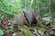 Part of a snubbing winch (artifact) along an abandoned sled road off the Gordon Pond Railroad in Kinsman Notch of the White Mountains, New Hampshire USA. This was a logging railroad in operation from 1907-1916.