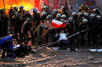 Chilean riot police officers scuffle with housing debtors during a protest in the Mapocho river in Santiago, Chile, June, 2009...Photo by Roberto Candia
