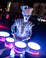 BNPS.co.uk (01202 558833)<br /> Pic: MaxWillcock/BNPS<br /> <br /> Lighting up the night.<br /> <br /> Pictured: A Spark! drummer performs to the crowds during the Sense of Unity parade through Weymouth in Dorset.<br /> <br /> Spark! is a street theatre show performed by five characters that combines high-impact drumming, dynamic choreography and beautiful lighting design.