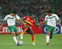 Mendonco (14) of Angola pulls the ball back from Omar Bravo (19) and Carlos Salcido (3) of Mexico. Mexico and Angola played to a 0-0 tie in their FIFA World Cup Group D match at FIFA World Cup Stadium, Hanover, Germany, June 16, 2006.