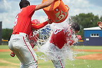 GCL Phillies East Jose Cedeno (16) dumps the Gatorade bucket full of water over Jose Tortolero after a walk-off sacrifice fly during a Gulf Coast League game against the GCL Yankees East on July 31, 2019 at Yankees Minor League Complex in Tampa, Florida.  GCL Phillies East defeated the GCL Yankees East 4-3 in the second game of a doubleheader.  (Mike Janes/Four Seam Images)