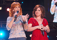"""11 June 2020 - Kelly Clarkson files for divorce from husband Brandon Blackstock. The """"Voice"""" coach and Blackstock, a music manager, have been married since October 2013 and have two children together, River Rose and Remington Alexander. Blackstock also has two children from a previous marriage. File photo: 07  June 2007 - Nashville, Tennessee - Reba McEntire and Kelly Clarkson. 2007 CMA Music Festival held at LP Field. Photo Credit: Laura Farr/AdMedia"""