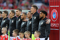 Ashley Williams of Wales (R) sings the national anthem with team mates during the FIFA World Cup Qualifier Group D match between Wales and Austria at The Cardiff City Stadium, Cardiff, Wales, UK. Saturday 02 September 2017