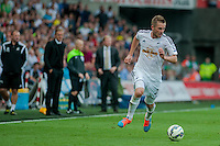 Saturday 20th September 2014  Pictured:  Gylfi Sigurosson makes a run for the ball while Garry Monk, Manager of Swansea City look on in the background <br /> Re: Barclays Premier League Swansea City v Southampton  at the Liberty Stadium, Swansea, Wales,UK