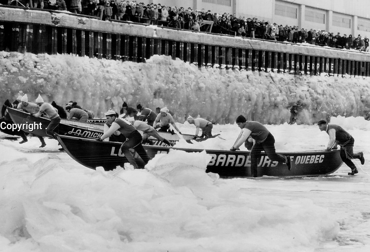 Most spectacular event of carnival is the ice canoe race across the floes and freezing waters of the St. Lawrence to Levis and back. The race; two miles in all; recalls the days before bridges spanned the St. Lawrence and rivermen were the life-line to may communities. Their enemy is a powerful current which can put the paddlers a mile out of their way in just a matter of a few minutes.<br /> <br /> PHOTO :  Jeff Goode - Toronto Star Archives - AQP