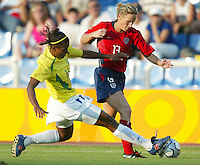 14 August 2004:   Kristine Lilly fights for the ball with Brazil Defender Rosana at Kaftanzoglio Stadium in Thessaloniki, Greece.   USA defeated Brazil, 2-0. Credit: Michael Pimentel / ISI