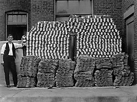 Manufacturing heavy wool socks for the Government at Chipman Knitting Mills, Easton, Pa.  The finished product, a pile of 84 needle heavy wool socks.  Ca. 1918. Chipman Knitting Mills.  (War Dept.)<br />Exact Date Shot Unknown<br />NARA FILE #:  165-WW-202E-3<br />WAR & CONFLICT BOOK #:  551