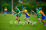 Kerry's Annemarie Leen been put under pressure from Clares Niamh Mulqueen, in the Munster Junior Camogie final