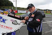 Oct. 2, 2011; Mohnton, PA, USA: NHRA crew member for funny car driver Leah Pruett during the Auto Plus Nationals at Maple Grove Raceway. Mandatory Credit: Mark J. Rebilas-