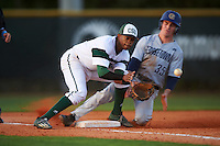 Chicago State Cougars third baseman Sanford Hunt (25) fields a throw as Ryan Davis (35) slides into third base during a game against the Georgetown Hoyas on March 3, 2017 at North Charlotte Regional Park in Port Charlotte, Florida.  Georgetown defeated Chicago State 11-0.  (Mike Janes/Four Seam Images)